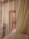 Mosquito net around our beds